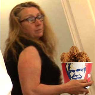 Suzanne Martin eating a bucket of KFC purchased with ringfenced backer funds meant for the Vega+ production