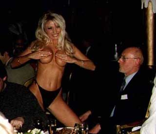 Sir Clive Sinclair with a topless woman